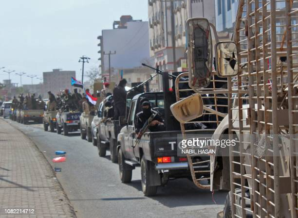 Yemenis military personnel drive their vehicles during the funeral procession of Brigadier General Saleh Tamah as it makes its way from alFardous...