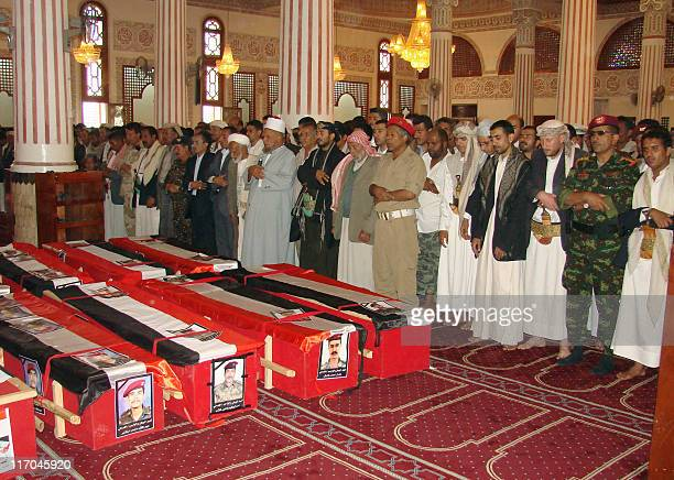 Yemenis pray over the coffins of soldiers killed during battles between powerful dissident tribal leader Sheikh Sadiq alAhmar's fighters and...