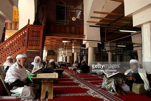 Yemenis read verses from the holy Quran inside the Grand Mosque of Sanaa�s historical old district where scores of small Yemeni youth take Islamic...
