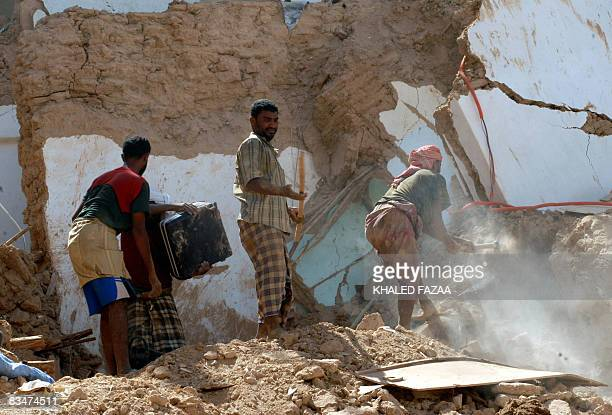 Yemenis search for their processions from under the rubble of their collapsed homes in the historical city of Shibam in Hadramaut province of eastern...