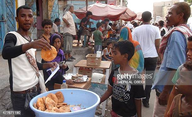 Yemenis shop at a market in the embattled southern Yemeni city of Aden on the first day of the holy Muslim fasting month of Ramadan on June 19 2015...