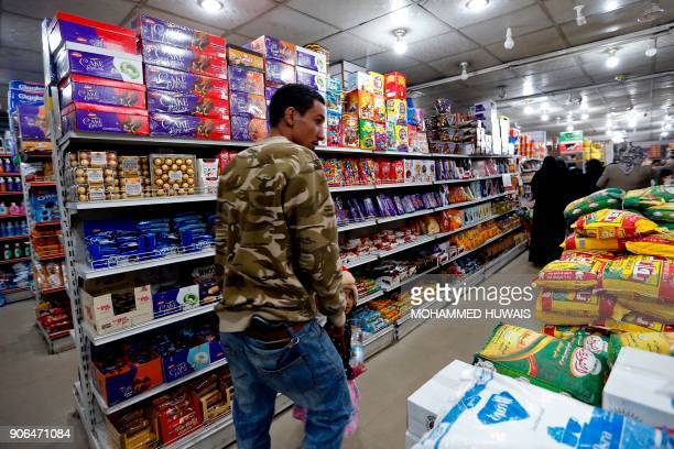 Yemenis shop at a supermarket in the capital Sanaa after the Yemeni currency rose 16 percent against the dollar on January 18 2018 For more than a...