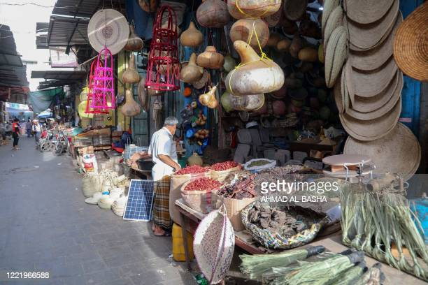 Yemenis shop for medicinal plants and spices at a market in Yemen's third city of Taez on June 15 2020 As medicines run short and hospital wards...
