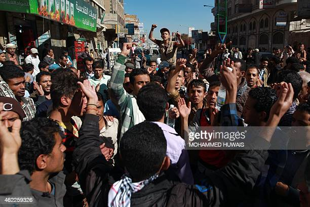 Yemenis shout slogans during a rally against the occupation of the capital by Shiite Huthi rebels on January 26 2015 in the capital Sanaa Yemen's...