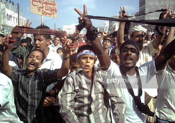 Yemenis shout slogans during an antigovernment protest in the AlHabilain town of Lahj province 320 kms south of Sanaa on December 19 2009 against an...