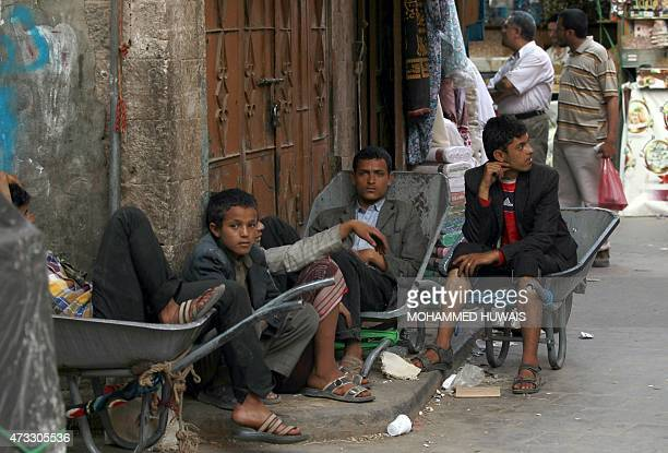 Yemenis sit on wheelbarrows at a market in the capital Sanaa's old city on May 14 2015 The United Nations calls on all parties to the Yemen conflict...