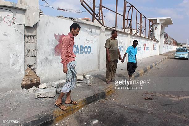 Yemenis stand at the site where a suicide bomber suspected of belonging to AlQaeda killed five Yemeni soldiers when he detonated his explosive belt...
