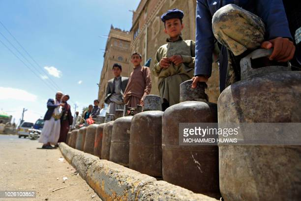 Yemenis wait for gas supply with their to empty cylinders amid increasing shortages in the Yemeni capital Sanaa on September 2 2018