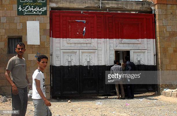 Yemenis walk past the prison in Taiz, south of Sanaa on July 5 following the execution of a Yemeni man, Akram al-Samawi by firing squad after being...