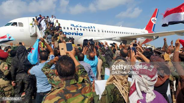 Yemenis welcome members of the new unity government at the Aden Airport on December 30 before explosions rocked the Yemeni airport. - Explosions...