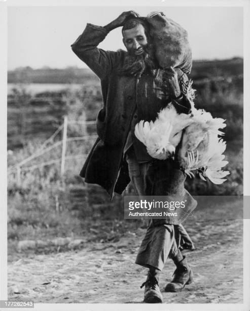 A Yemenite farmer carrying chickens back home as photographed by Israeli photographer David Rubinger Israel circa 19451965