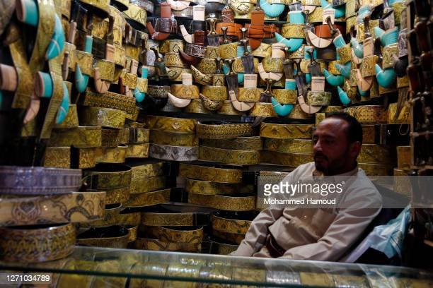 Yemen's dagger vendor displays some for sale as he waits for customers inside his shop at a market on September 06, 2020 in Sana'a, Yemen. The five...