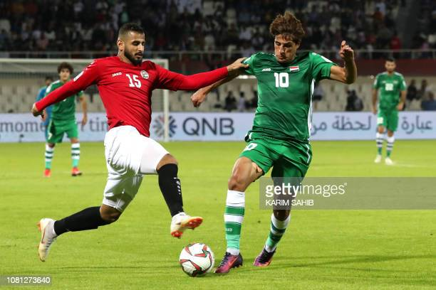 Yemen's defender Ammar Hamsan vies for the ball with Iraq's forward Mohanad Ali Kadhim Alshammari during the 2019 AFC Asian Cup group D football...