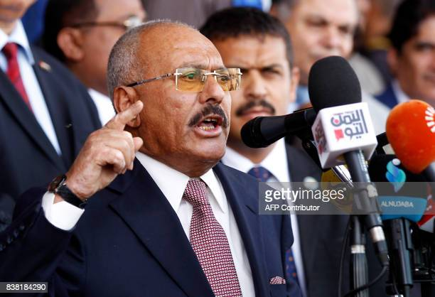 Yemen's expresident Ali Abdullah Saleh gives a speech addressing his supporters during a rally as his General People's Congress party marks 35 years...