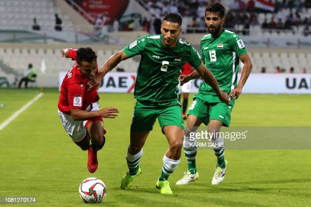 Yemen's forward Ahmed Al Sarori is marked by Iraq's defender Ali Adnan during the 2019 AFC Asian Cup group D football match between Yemen and Iraq at...
