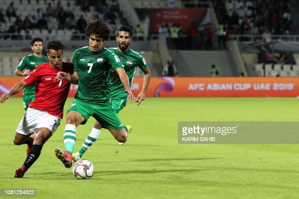 Yemen's forward Ahmed Al Sarori is marked by Iraq's midfielder Safaa Hadi AlFuraiji during the 2019 AFC Asian Cup group D football match between...