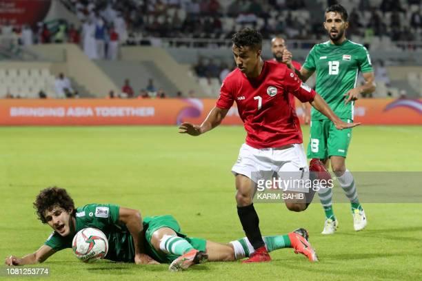 Yemen's forward Ahmed Al Sarori vies for the ball with Iraq's midfielder Safaa Hadi AlFuraiji during the 2019 AFC Asian Cup group D football match...