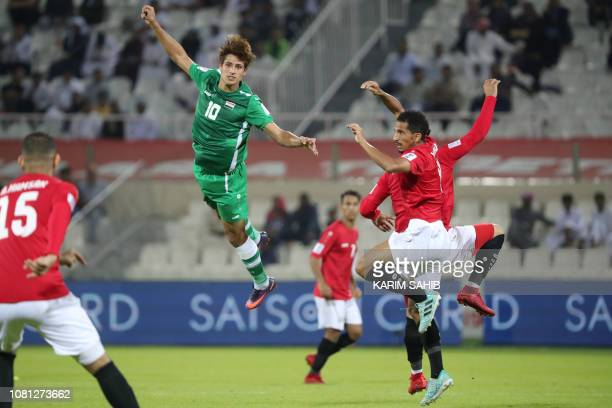 Yemen's forward Ahmed Dhabaan heads the ball during the 2019 AFC Asian Cup group D football match between Yemen and Iraq at Sharjah stadium in...