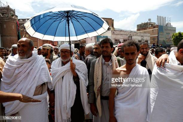 Yemen's Houthi loyalists wearing the pilgrimage dress, called ihram, as they participate in a rally celebrating the anniversary of Eid al-Ghadir...