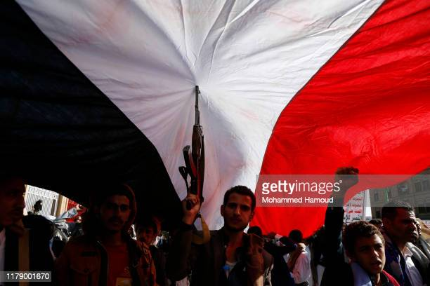 Yemen's Houthi supporters rally against the ongoing war and blockade on October 04 2019 in Sana'a Yemen