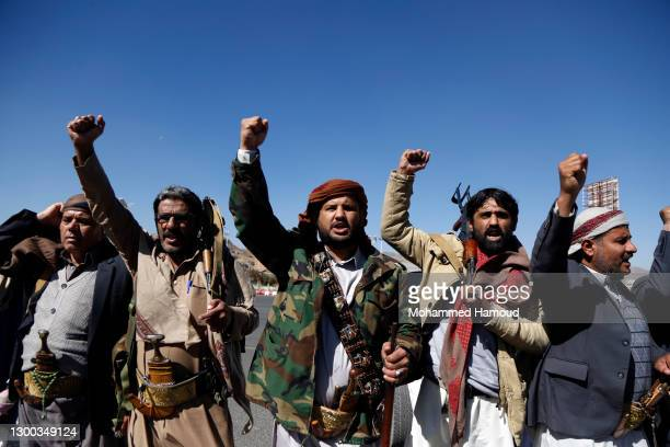 Yemen's Houthi supporters shout slogans as they take part in a gathering to donate for fighters who fight against forces of the government of Abd...
