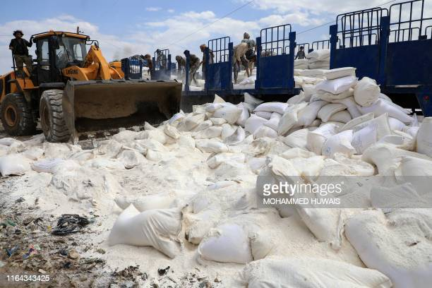 TOPSHOT Yemen's Huthi rebels dispose of expired aid packages from the World Food Programme in the capital Sanaa on August 27 2019 Yemen's Huthi...