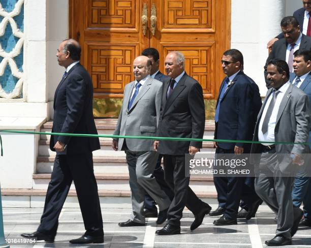 Yemen's internationally recognised government President Abedrabbo Mansour Hadi walks with Arab League SecretaryGeneral Ahmed Aboul Gheit during their...
