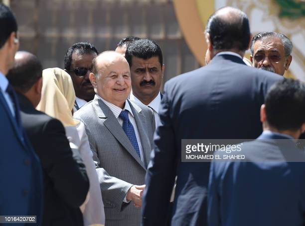 Yemen's internationally recognised government President Abedrabbo Mansour Hadi greets officials as he walks with the Arab League secretarygeneral...