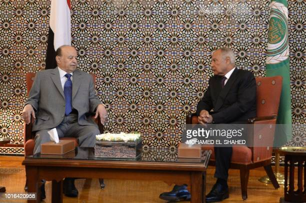 Yemen's internationally recognised government President Abedrabbo Mansour Hadi listens to the Arab League SecretaryGeneral Ahmed Aboul Gheit during...