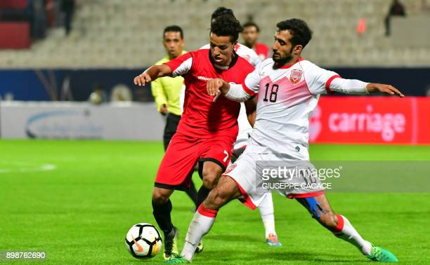 Yemen's midfielder Ahmed AlSarori vies for the ball against Bahrain's midfielder Ahmed Abdulla Ali during their 2017 Gulf Cup of Nations group match...