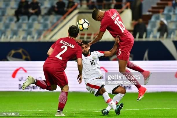 TOPSHOT Yemen's Mohsen Mohamed vies for the ball with Qatar's Pedro Miguel and Bassam alRawi during their 2017 Gulf Cup of Nations football match...