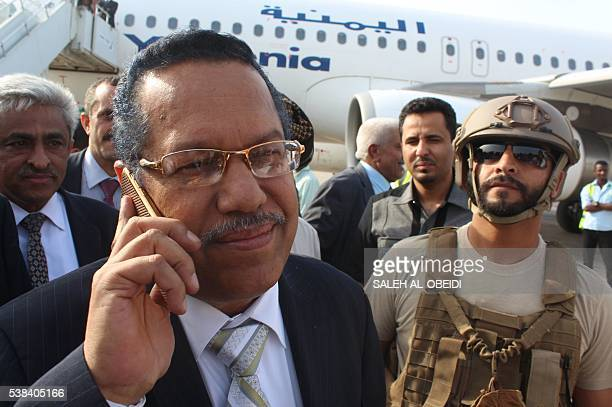 Yemen's Prime Minister Ahmed bin Dagher disembarks from a plane as he returns from the Saudi capital Riyadh on June 6 at the International Airport of...