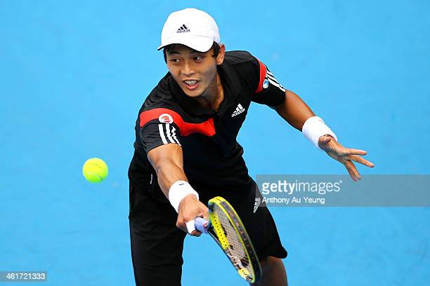 Yen Hsun Lu of Taiwan plays a backhand in the singles final against John Isner of United States during day six of the Heineken Open at ASB Tennis...