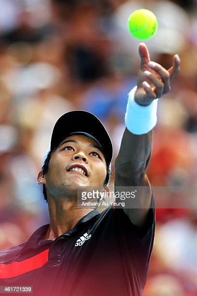 Yen Hsun Lu of Taiwan serves in the singles final against John Isner of United States during day six of the Heineken Open at ASB Tennis Centre on...