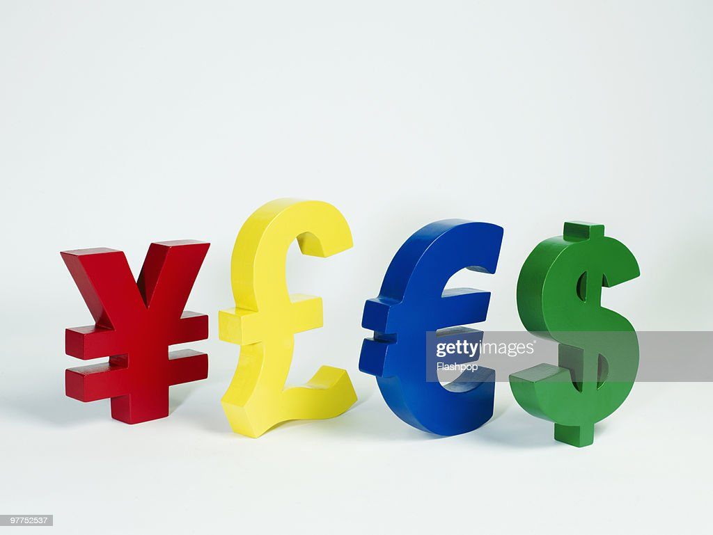 yen pound euro and dollar signs in a row stock photo getty images