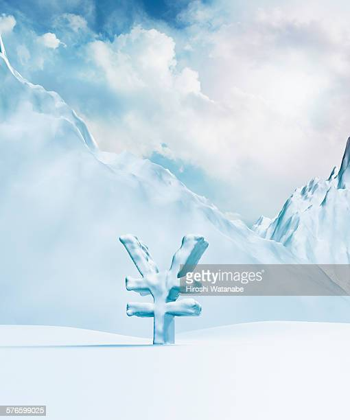 Yen symbol and mountains are covered with snow (Ri