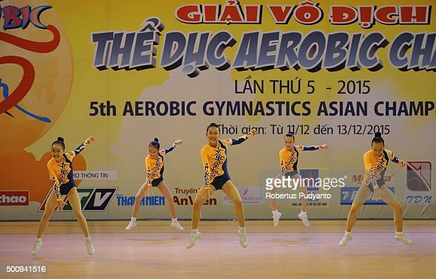 Yen Vy Trinh Nhat Anh Mai Ngoc Phuong Anh Pham Thuy An Hoang and Phuong Thuy Linh Tran of Vietnam compete in Qualification Age Group 1 Groups during...