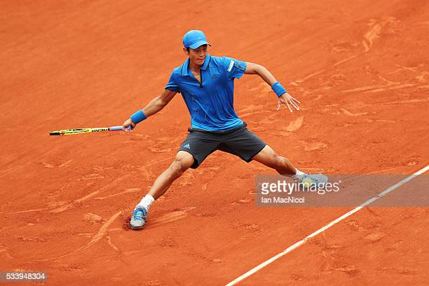 YenHsmen of Chinese Taipei plays a shot during the Men's Singles first round match against Novak Djokovic of Serbia on day three of the 2016 French...