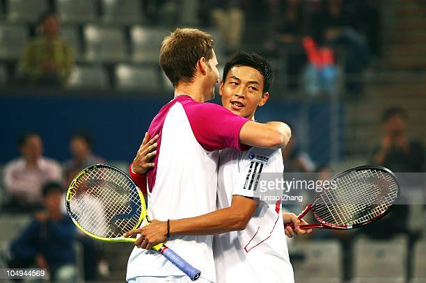 Yen-Hsun Lu of China and Florian Mayer of Germany celebrate after winning the match against Mao-xin Gong of China and Zhe LI of China during day...
