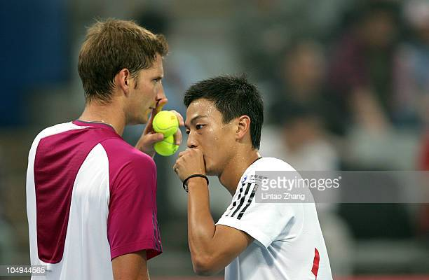 Yen-Hsun Lu of China and Florian Mayer of Germany plays against while playing Mao-xin Gong of China and Zhe LI of China during day seven of the 2010...