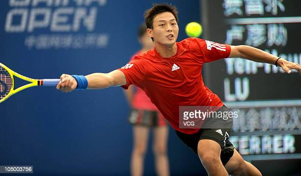 Yen-Hsun Lu of China competes during his match against David Ferrer of Spain during day seven of the 2010 China Open at the National Tennis Center on...