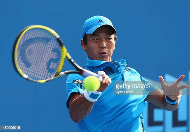 Yen-Hsun Lu of Chinese Taipei plays a backhand in his second round match against Grigor Dimitrov of Bulgaria during day four of the 2014 Australian...