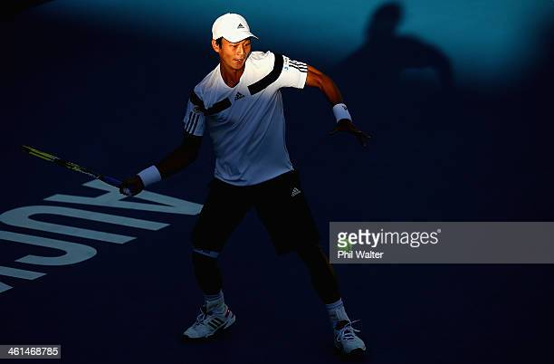 Yen-Hsun Lu of Chinese Taipei plays a forehand against Steve Johnson of the USA during day four of the Heineken Open at ASB Tennis Centre on January...