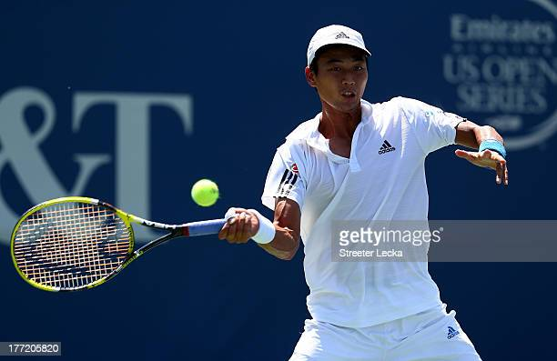 Yen-Hsun Lu of Chinese Taipei returns a shot to Alexandr Dolgopolov of Ukraine during day 5 of the Winston-Salem Open at Wake Forest University on...
