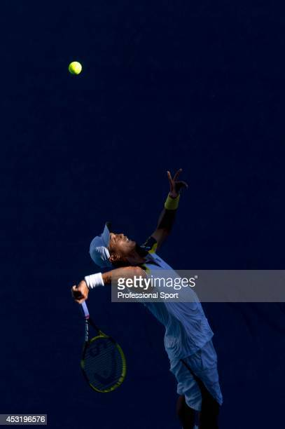 Yen-Hsun Lu of Chinese Taipei serves in his second round match against Gael Monfils of France during day four of the 2013 Australian Open at...