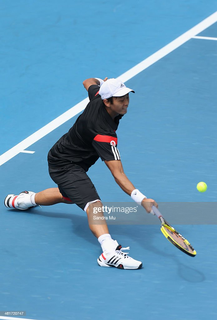 Yen-Hsun Lu of Chinese Tapei plays a forehand during his finals match against John Isner of the USA on day six of the Heineken Open at the ASB Tennis Centre on January 11, 2014 in Auckland, New Zealand.