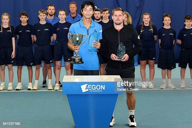 Yen-Hsun Lu of Taipei and Vincent Millot of France pose with their trophies after their men's singles final match during the final day of the Aegon...