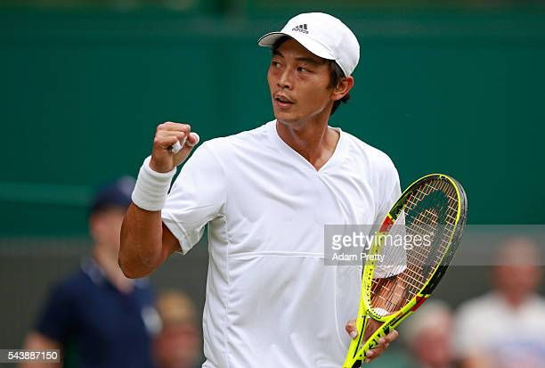 Yen-Hsun Lu of Taipei celebrates during the Men's Singles second round match against Andy Murray of Great Britain on day four of the Wimbledon Lawn...