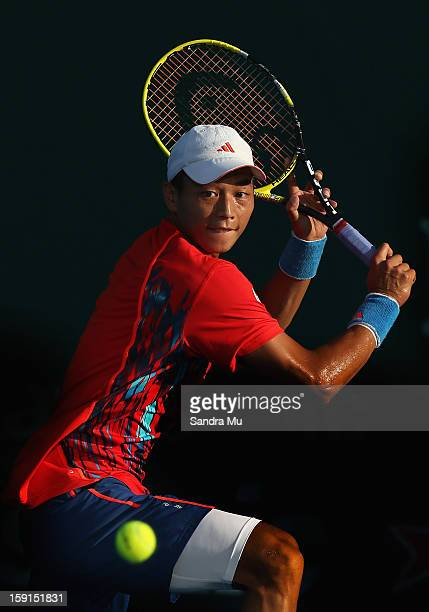 Yen-Hsun Lu of Taipei plays a backhand in his second round match against David Ferrer of Spain during day three of the Heineken Open at ASB Tennis...