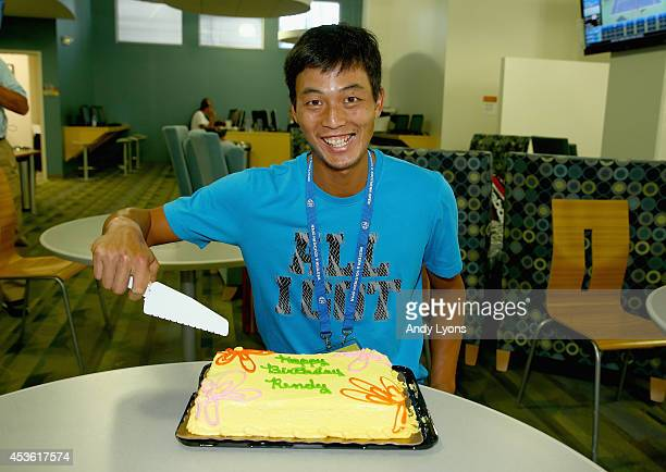 YenHsun Lu of Taipei poses with his birthday cake as he celebrates his birthday on Day 6 at the Western Southern Open on August 14 2014 at the Linder...